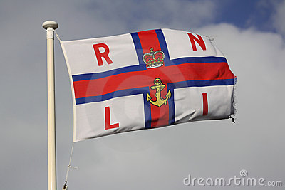 RNLI flag flying on flagpole Editorial Stock Photo