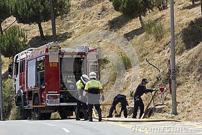 Road closed by a fire and firefighters working Editorial Image