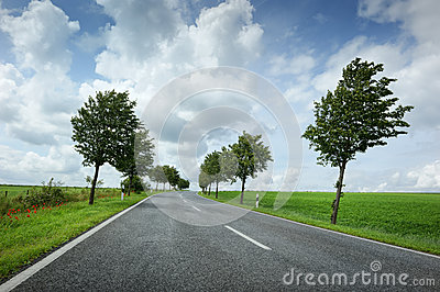 Road with cloudy sky