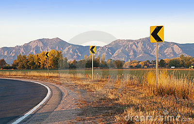 Road Curve Signs with Scenic Backdrop