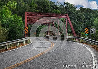 Road Curves Through Bridge
