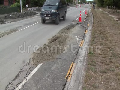 Road damage. CHRISTCHURCH, NEW ZEALAND, FEBRUARY 23, 2011 - Detail of road damage in East Brighton after a 6.4 earthquake in Christchurch, South Island, New stock video footage