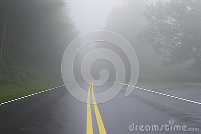 Road Danger Disappearing Into Fog
