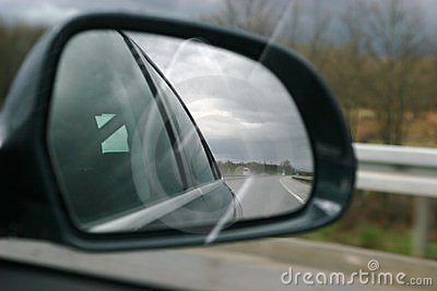 Road reflecting in wing mirror
