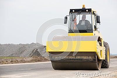 Road roller during asphalt paving works