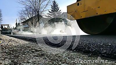Road roller on hot asphalt. Road roller carried repair works on city streets,video clip