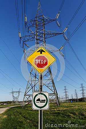 Road sign + electrical towers