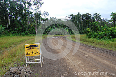 Road sign on haulage road in Papua New Guinea