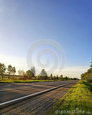 Road in spring and blue clear sky Stock Photo