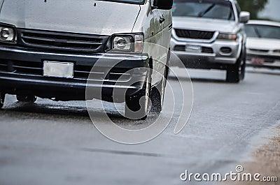 Road traffic driving in rain