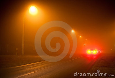 Road in a very foggy night