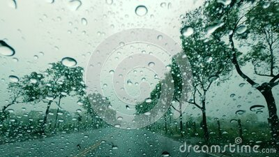 Road view through car window with rain drops, Driving in the rain stock video footage