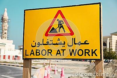 Road Warning Sign - Labor at Work writen on a arab and english language