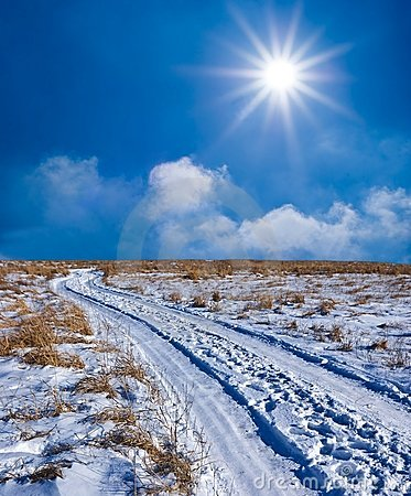 Road in a winter snowbound plain