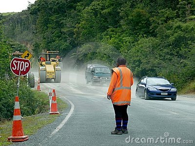Road works: woman worker with stop sign and cars Editorial Image