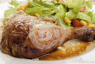 Roast chicken leg with salad