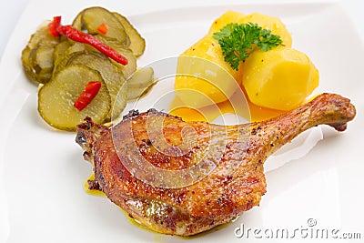 Roast duck leg with potatoes
