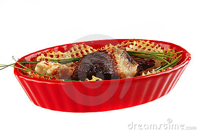 Roast meat in red bowl