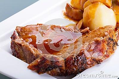 Roast pork with gravy and potatoes