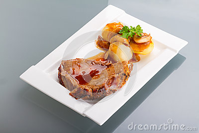 Roast Pork With Gravy And Potatoes Royalty Free Stock Photo - Image: 29224955