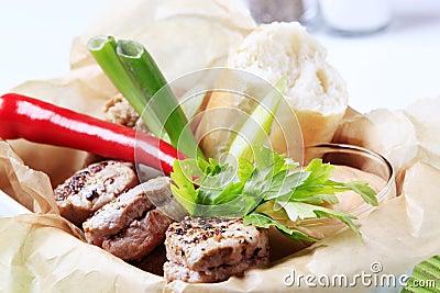 Roast pork tenderloin with roll and sauce