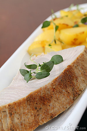 Roast tuna steak and potatoes