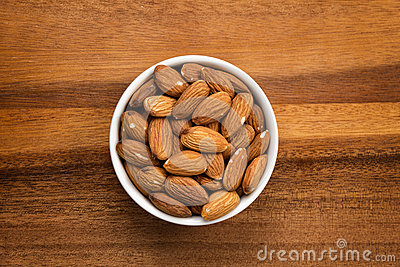 Roasted almonds in white porcelain bowl