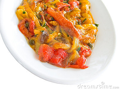 Roasted bell pepper salad on white dish.
