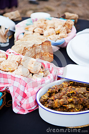 Roasted bread and mutton kebabs in dishes