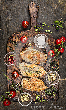 Free Roasted Chicken Breast With Fried Herbs And Tomatoes On Rustic Cutting Board, Top View Stock Images - 59027354