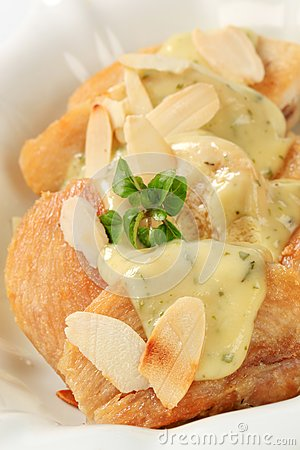 Roasted chicken with herb sauce and almonds