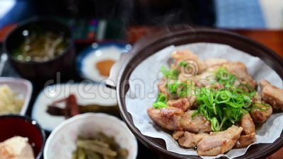 Japanese food. Roasted chicken in a hotpot is a healthy Japanese dish stock video footage