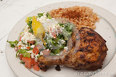 Roasted chicken with saffron rice and greek salad