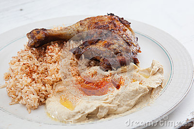 Roasted chicken with saffron rice and hummus