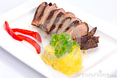 Roasted duck breast with potatoes