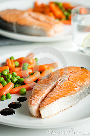 Roasted salmon with vegetable garnish