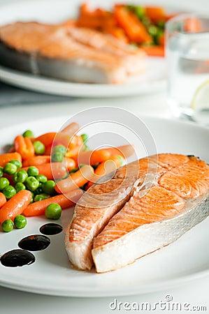 Roasted salmon with vegetable garnish