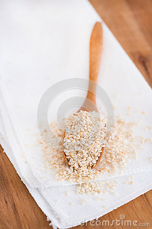 Roasted sesame seeds on a wooden spoon
