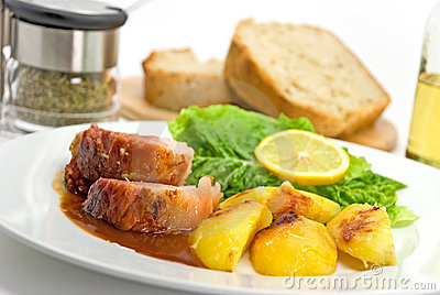 Roasted Slices Of Pork With Lettuce And Fried Pota