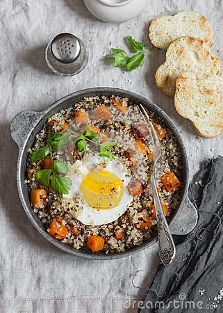 Free Roasted Sweet Potato, Quinoa And Fried Egg Bowl. Delicious Healthy Breakfast Or Lunch. Stock Photos - 85523413
