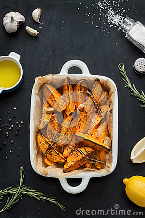 Free Roasted Sweet Potatoes In White Ceramic Dish Stock Photography - 65519782