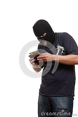 Robber counts money from stolen wallet.