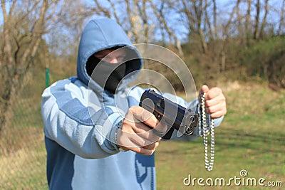 Robber with a gun