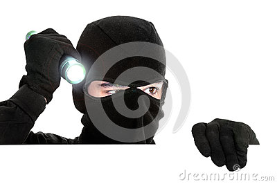 Robber hiding under a white wall