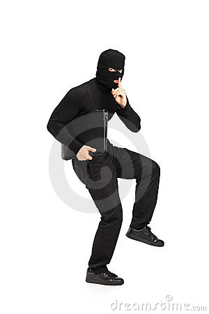 Robber holding a briefcase with finger on the lips