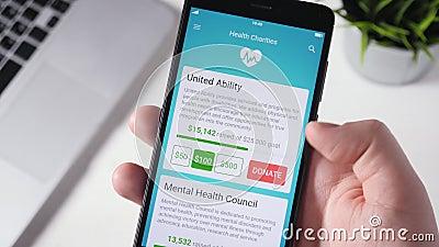 Robić dobroczynności darowiźnie zdrowie organizacja Używać Smartphone App zbiory wideo