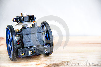 A robot with eyes on wheels stock photo image 54814724 for Robot motors and wheels
