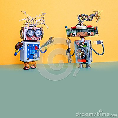 Free Robots Automation Maintenance Service Concept. Handyman Robotic Characters With Hand Wrench And Pliers. Yellow Wall Royalty Free Stock Image - 117140716