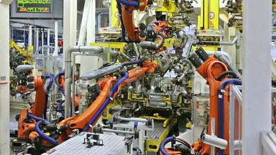 Robots in a car factory. MLADA BOLESLAV, CZECH REPUBLIC - MAY 30: Skoda Auto celebrates 120 years since its establishemnt by Open Doors Day on May 30, 2015 in
