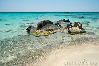 Rock in the clear blue water, Crete